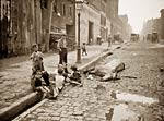 Dead horse, cobbled street, children playing in New York