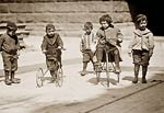 Children with tricycles, streets of New York 1909