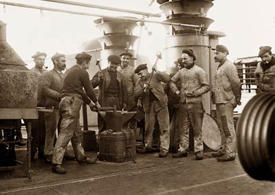 Sailors at work aboard Amiral Aube navy ship