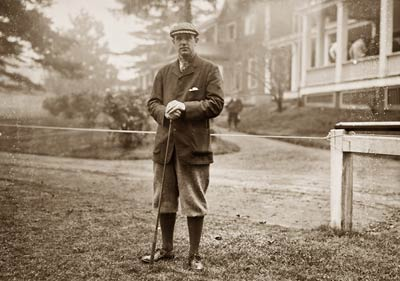 Findlay S. Douglass, with golf club, Baltusrol
